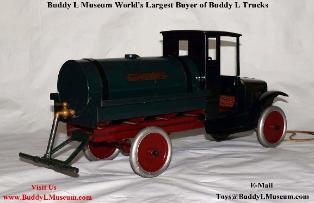 buddy l oil truck, 1920's Buddy L Oil Truck for sale, vintage tin toys, cast iron toys,  Buddy L Museum, buddy l sprinkler truck, buddy l oil tanker, antique buddy l oil truck with sprinkler bar Free Toy Appraisals www.buddylmuseum.com